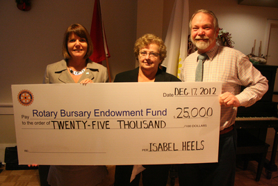 The estate of the late Gravenhurst resident Isabel Heels handed over $25,000 to the Rotary Club's bursary endowment fund, bringing the estate's total contribution to the local club's efforts $80,000. From left to right at the presentation Dec. 17 are former co-employees with Heels, Paula Wilford and Pat Grisdale along with fund committee chair Ken Little. (Photo by Neil Etienne)